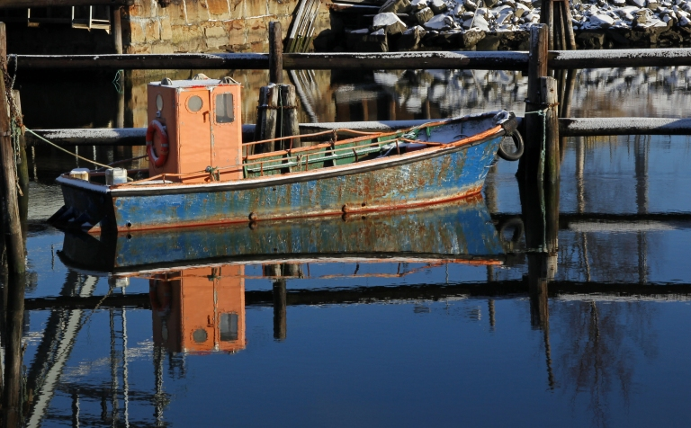 old rusty boat reflected