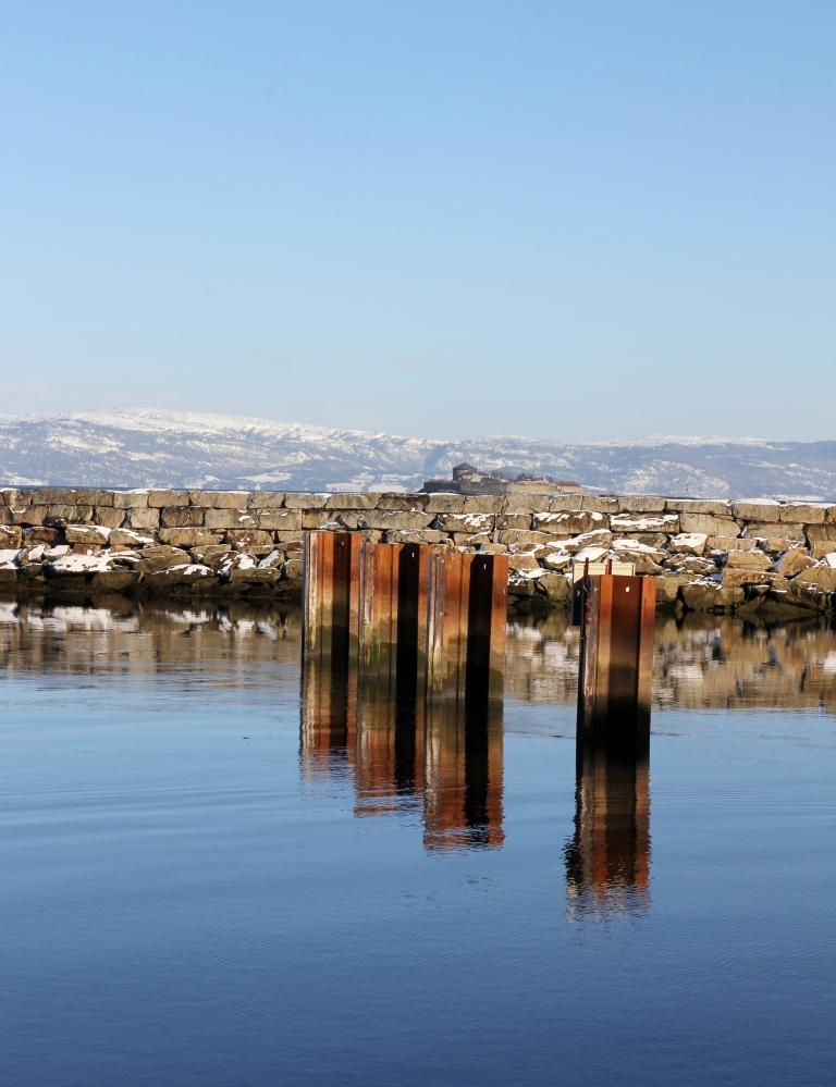 poles in water towards Munkholmen