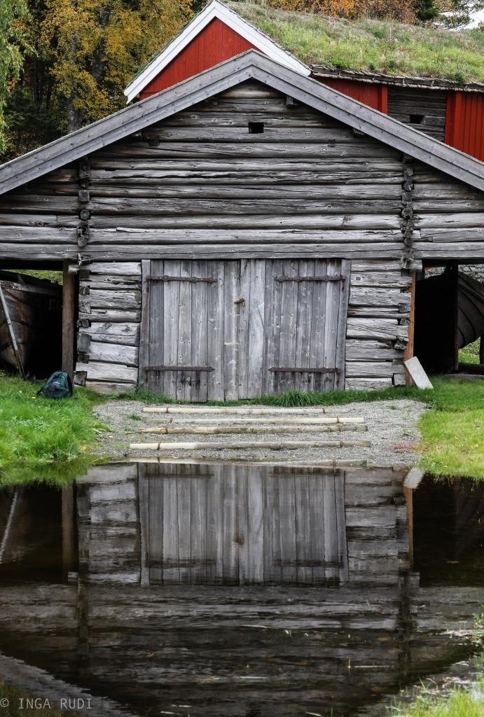 old boathouse reflected